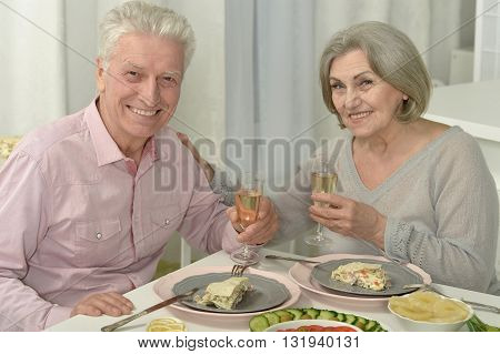 Portrait of a happy senior couple resting at cafe