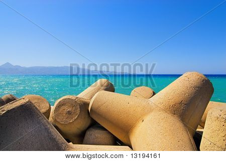 Seashore with concrete breakwater cones