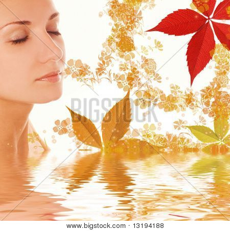 Beautiful girl and colorful autumn leaves in rendered water