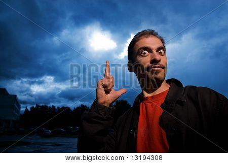 Funny guy over dark cloudy sky before rain