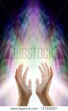 Sensing Matrix Energy Field - female hands reaching up into a multicolored matrix energy field with a burst of rising white light