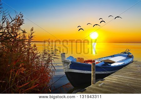 sunset laka and boat