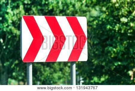 Red and white road sign on right at sunny day