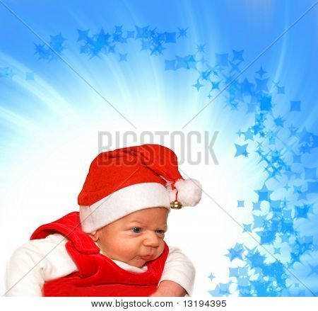 Adorable baby in Santa suit on abstract background