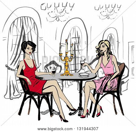 Two women sitting in luxury restaurant and drinking wine