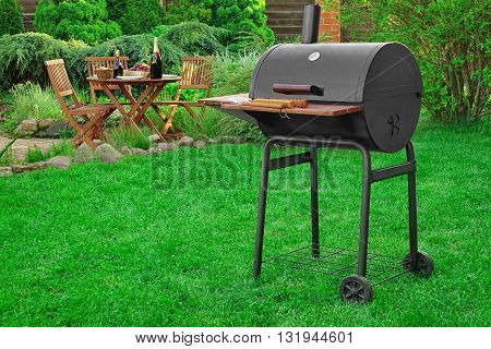 Scene Of Barbecue Grill Party On Lawn In The Backyard