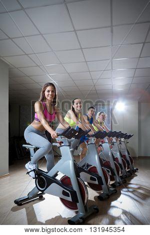 Athlete on bicycle indoors