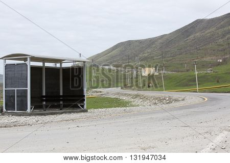 Old bus stop in mountains. Majestic mountains landscape, fjord in Norway with wooden bus stop