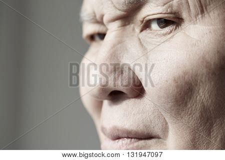 Face of elderly man looking at camera. Horizontal photo