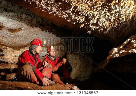 Geologists Studying Minerals In A Cave