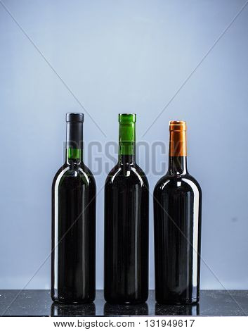 Set of white, rose, and red wine bottles.isolated on white background.Set 5 bottles of wine with white labels isolated on white background.