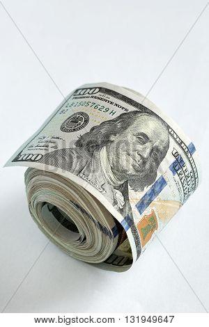 Cash Money.US dollars bundle on a light background .