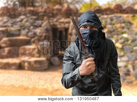 Terrorist Threatening With Bloody Blade. Terrorism Concept.