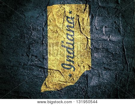 image relative to usa travel. indiana state yellow outline map on blue concrete backdrop