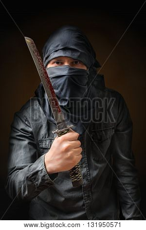 Terrorist Threatening With Bloody Knife. Low Key Photo.