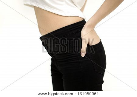 sport, fitness and diet concept - close up of trained belly with measuring tape. Closeup on fitness woman showing flat belly.