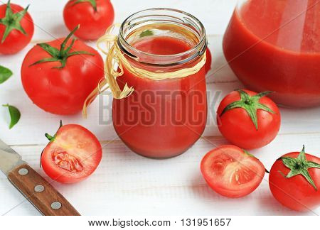 Fresh homemade tomato juice in glass jar, delicious healthy snack