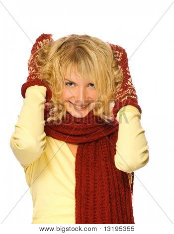 Beautiful blond girl with blue eyes in winter clothing touching her hair