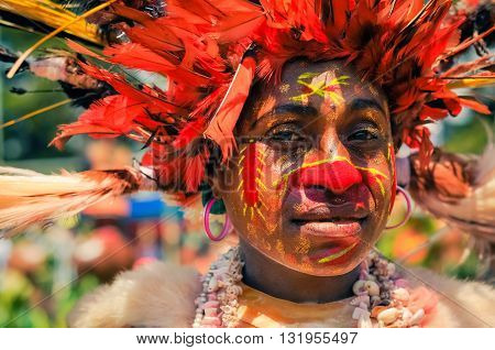 Woman With Earrings In Papua New Guinea