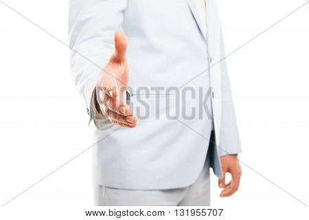 Close up of businessman wearing light suit extended his hand to handshake isolated on white background