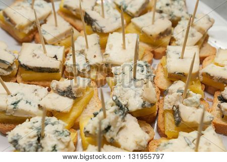 stack of vegetarian tapas starters sandwiches with blue cheese and pine slice