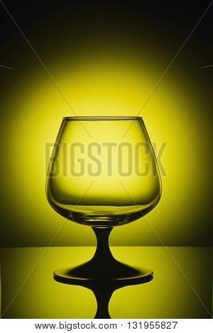 Empty wine glass in the yellow light