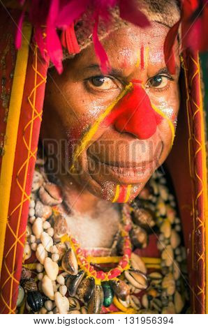 Woman With Red Nose In Papua New Guinea