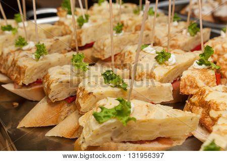 stack of vegetarian tapas starters tortilla on metallic platter