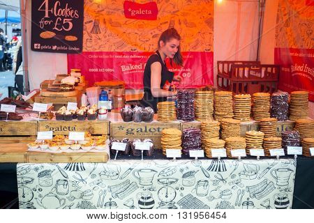 LONDON, ENGLAND - May 14, 2016 : Street food festival on the street of London, England. London is the capital and most populous city of England, Britain, and the United Kingdom.