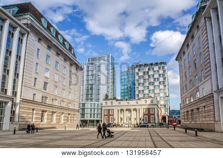LONDON, ENGLAND - May 14, 2016 : People walking on the street of London, England. London is the capital and most populous city of England, Britain, and the United Kingdom.