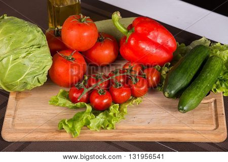 Fresh salad vegetables tomatoes cabbage pepper and salad - close up photo frome above