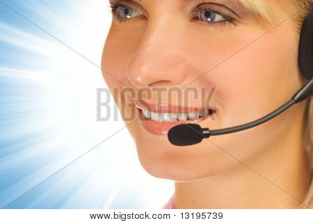 Beautiful hotline operator with headset on abstract background