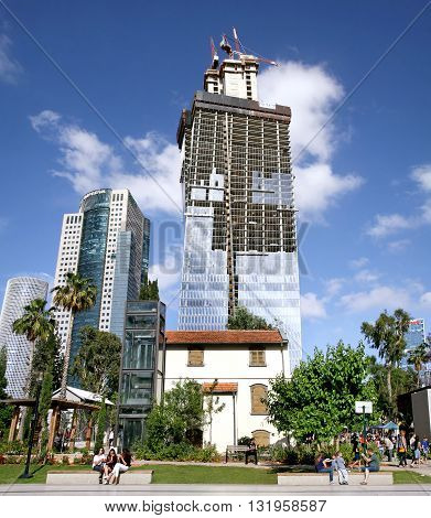 TEL AVIV ISRAEL - APRIL 27 2016: Construction of high-rise building in entertainment Sarona quarter in Tel Aviv