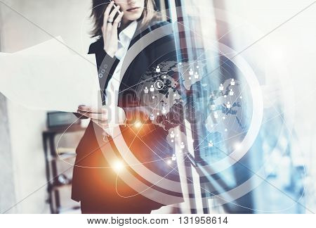 Photo business woman wearing black suit, talking smartphone and holding papers hands.Open space loft office.Panoramic windows background.Connections world wide interfaces.Horizontal, flares.Film effect