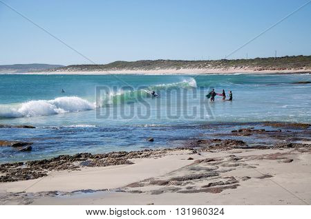 KALBARRI,WA,AUSTRALIA-APRIL 20, 2016: People body boarding the waves in the turquoise Indian Ocean at the tourist destination Jake's Point in Kalbarri, Western Australia.