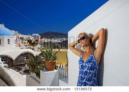 Beautiful blond girl on Santorini Island (Greece)