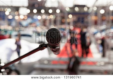 Microphone in focus against blurred background. News conference.