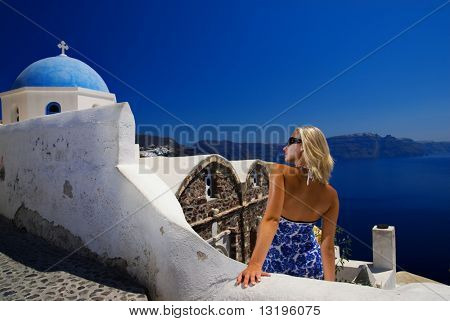Beautiful blond girl on Santorini Island (Greece)