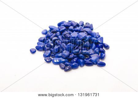 Small ornamental blue stones on white background
