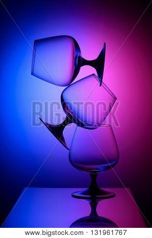 Three empty glasses in the bicolor light