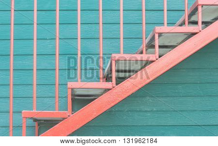 iron staircase and green wall wood background