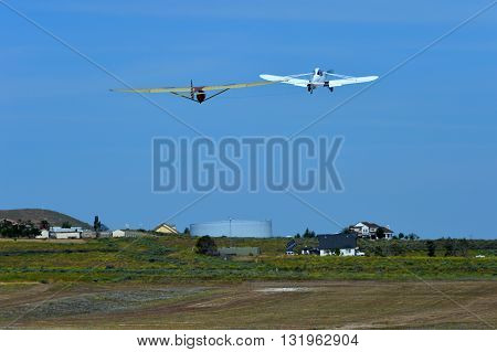 TEHACHAPI, CA - MAY 28, 2016: A classic 1930s era glider, the Bowlus Baby Albatross, gets a tow to altitude during the Western Vintage/Classic Regatta.