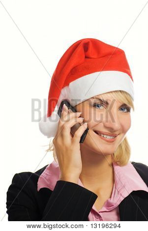 Business woman in Christmas hat talks on the phone. Isolated on white background