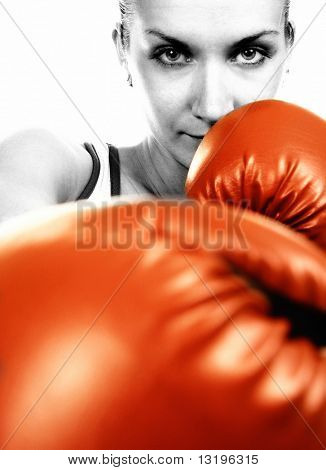Sepia portrait of a girl in red boxing gloves