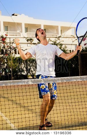 Tennis player screaming after winning a game