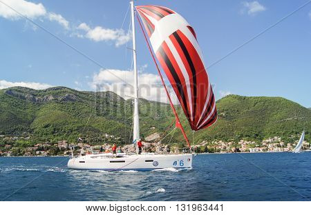 Tivat, Montenegro - 26 April, The yacht with a multi-colored sail, 26 April, 2016. Regatta