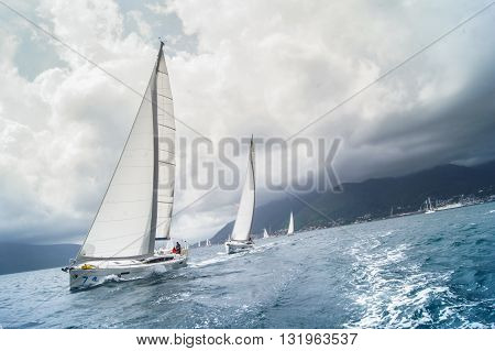 Tivat, Montenegro - 28 April, Sailboat coming one after the other with a large roll,28 April, 2016. Regatta