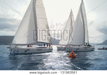 Tivat, Montenegro - 28 April, Boats pass by the buoy, 28 April, 2016. Regatta