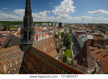 Top view of Kosice (Slovakia) from Saint Elisabeth Cathedral tower. Multicolored tile roof of cathedral in foreground.