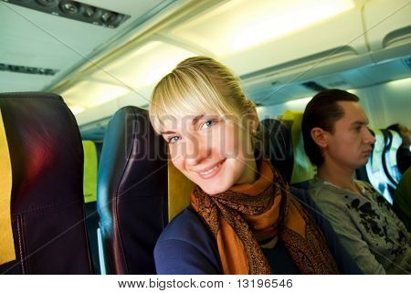 Happy passenger in aircraft
